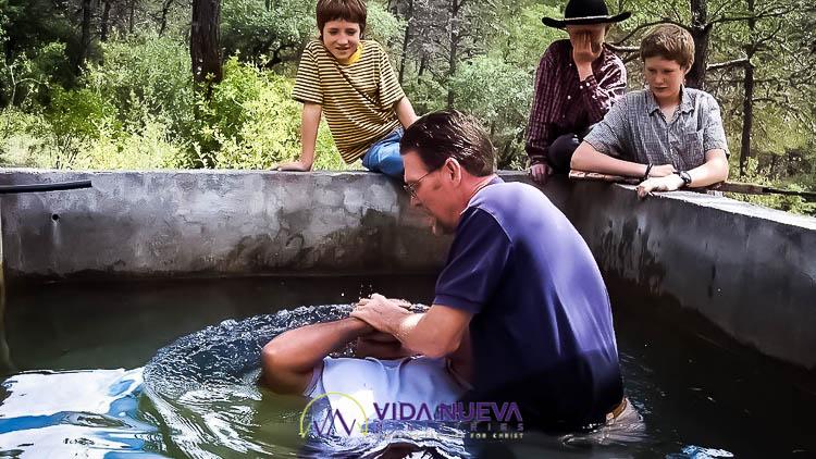 man baptized