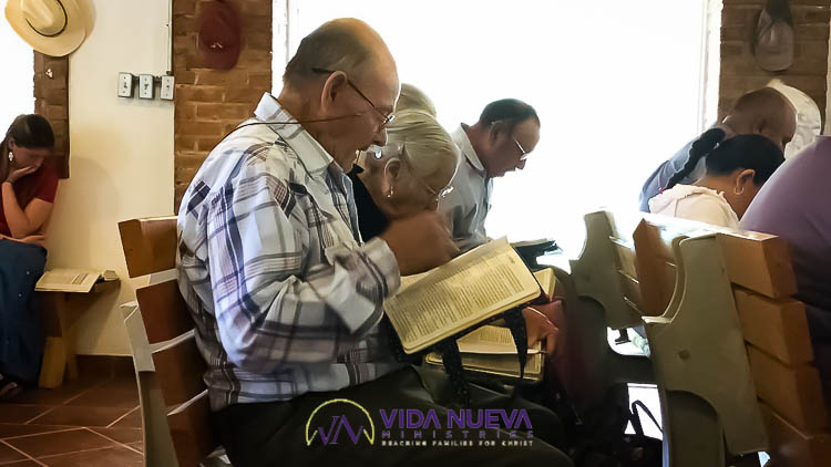 man reading bible in a church